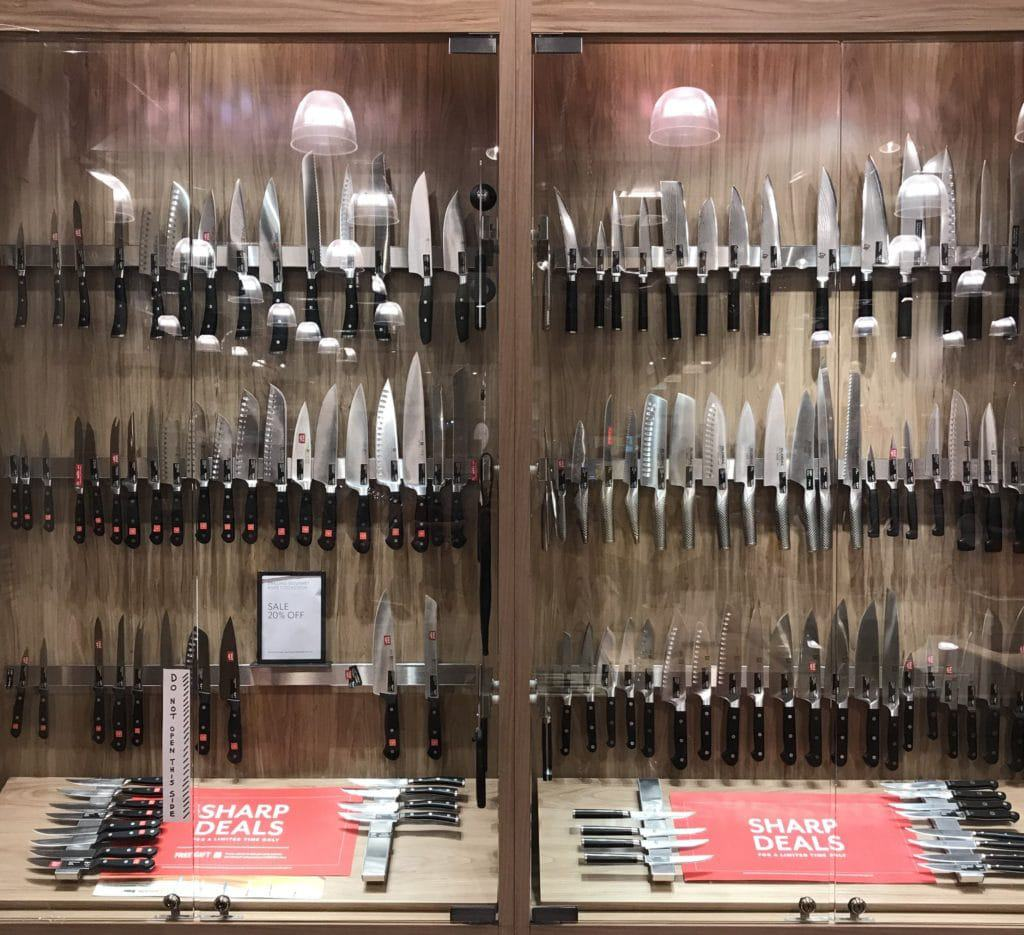 Wusthof and Henckels knives in the case at Williams Sonoma