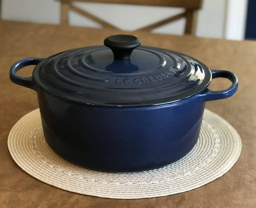 Le Creuset 5.5 quart Dutch oven on dining room table
