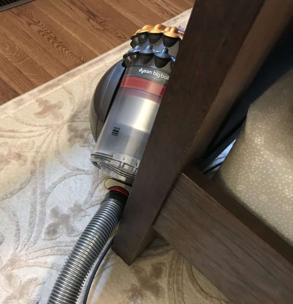 canister vacuum stored in closet