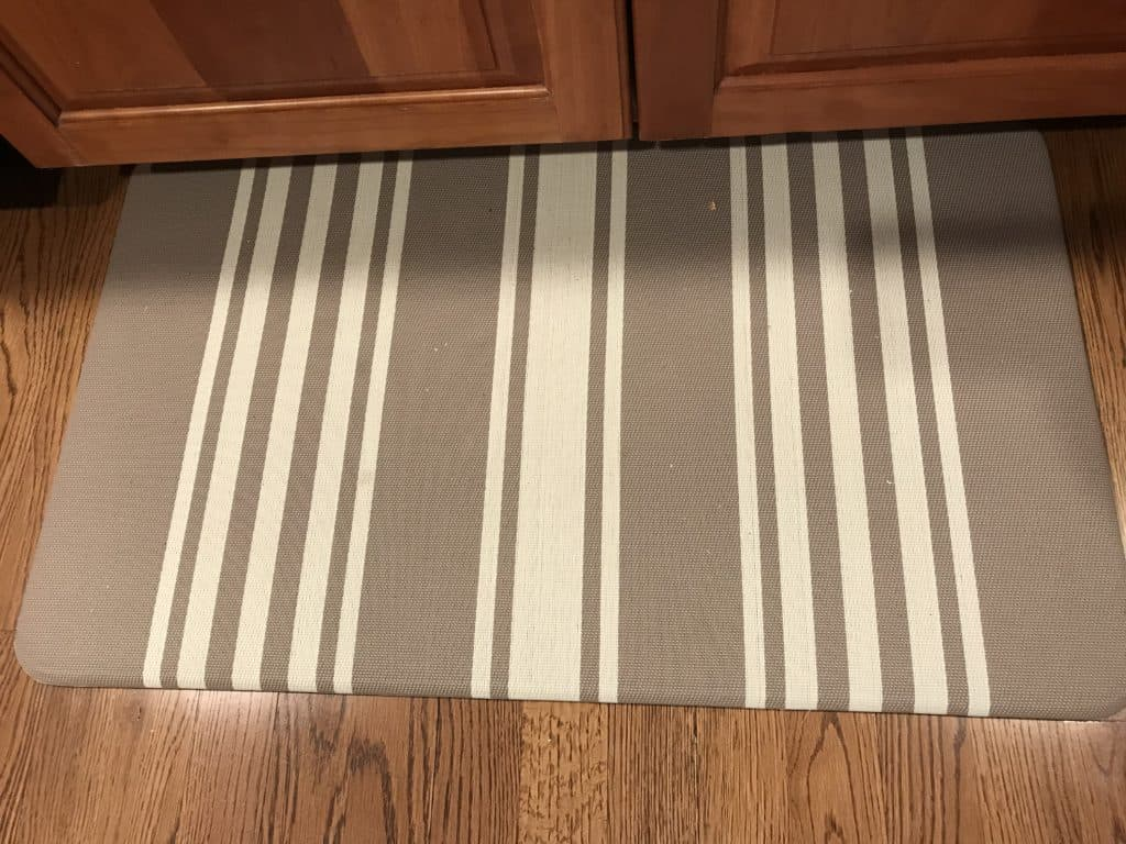 Dirty anti-fatigue mat in kitchen