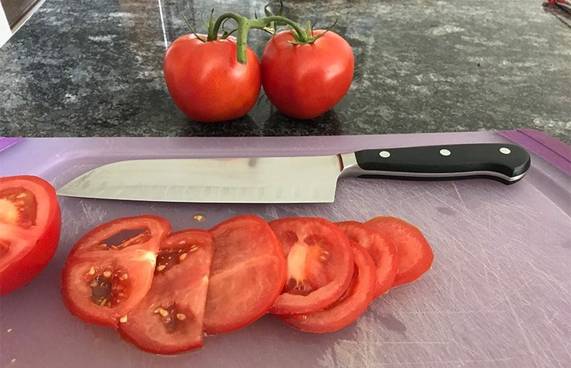 Wusthof Classic Santoku Knife Cutting Tomatoes