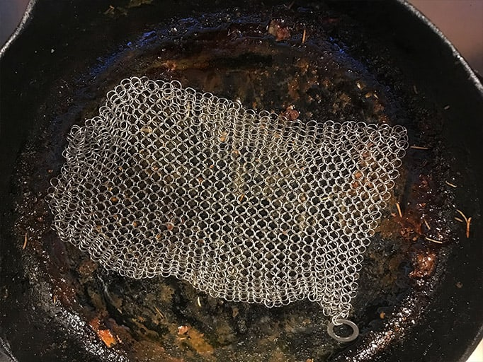 Cleaning a cast iron skillet with The Ringer
