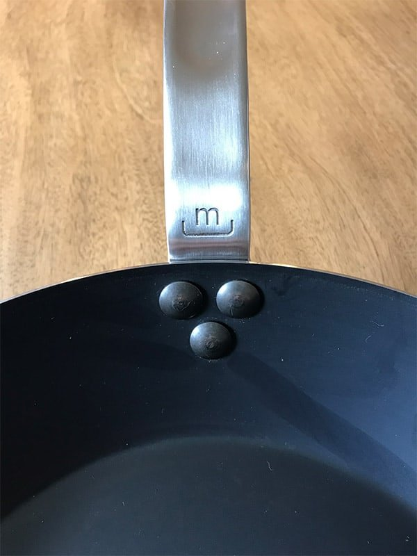 Made In engraved logo on the handle of the carbon steel frying pan