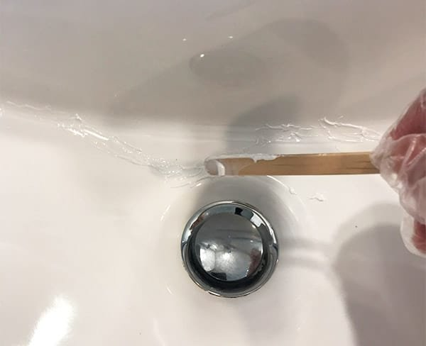 Applying Resin to Fix Cracked Porcelain Sink