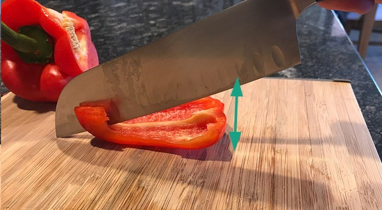 Chopping a pepper with a santoku knife