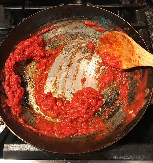 Tomato sauce stripping the seasoning off carbon steel cookware