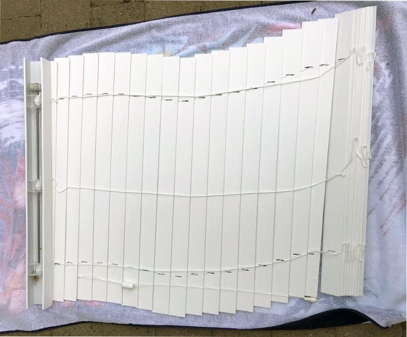 Cleaning vinyl blinds outside