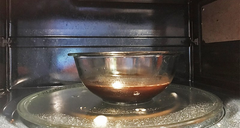 Using coffee grounds to get rid of the burnt smell in the microwave