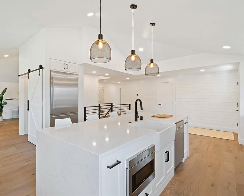 Modern kitchen with solid white quartz countertops