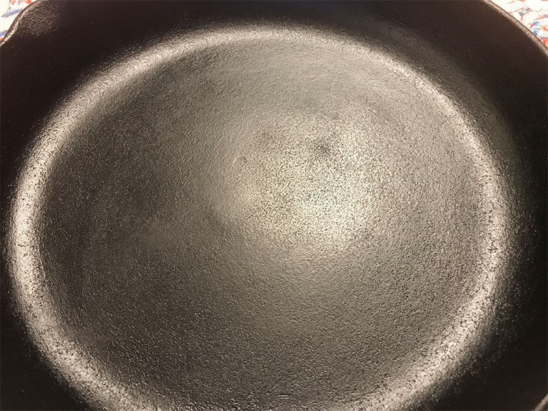 Bare cast iron durable cooking surface