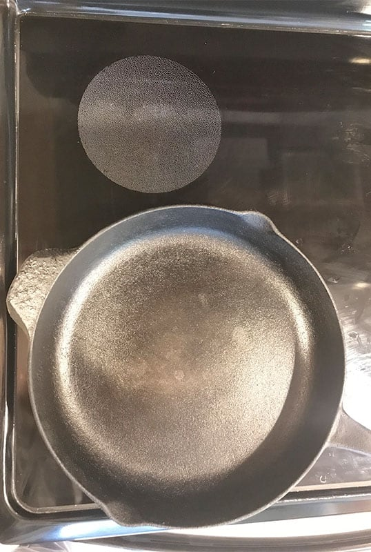 Electric stove burner too small for large cast iron skillet