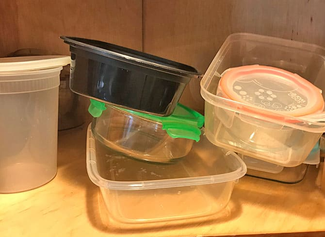 Kitchen cabinet with disorganized storage containers