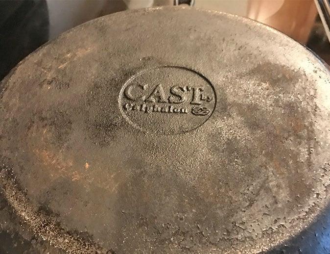Logo on the bottom of a Calphalon cast iron skillet