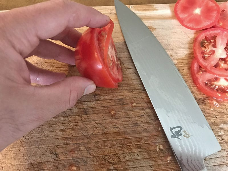 Making thin slices with a Shun kitchen knife