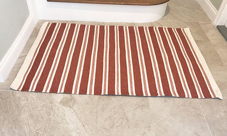 Using a rug or mat to make tile floors less slippery